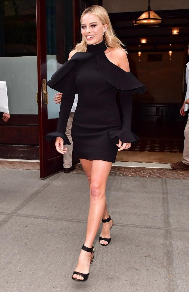 Margot Robbie wore a LBD with flared sleeves by Elie Saab for her appearance on the Tonight Show with Jimmy Fallon. Picture: James…