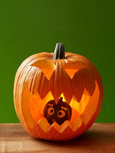 Place a small pumpkin or acorn squash inside a larger pumpkin to make this hilarious jack o lantern.