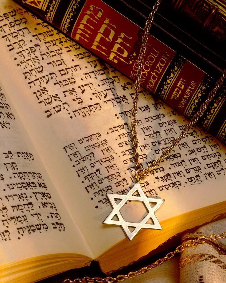 Jewish Star or Mogan David or Star of David laying on Hebrew prayer books.