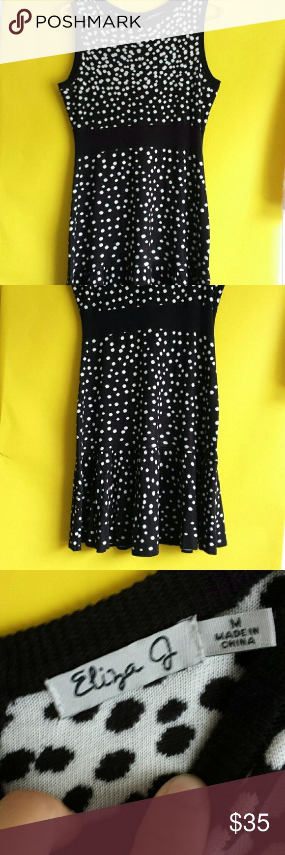 """Graphic Black & White Dot Knit Dress Size Medium Talk about cute & stylish with a timeless black and white print. This dress is 100% acrylic knit and a great piece for dressing up or down.  Has a great midweight to it.  Feminine detaiels like black band defining waist and subtle bottom kick pleats. Back zipper closure.  Size Medium,  18"""" with stretch, 36"""" long Eliza J Dresses Midi"""