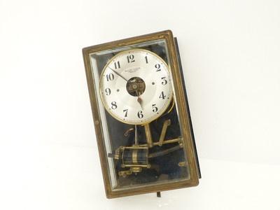 Pendule horloge mural éléctromagnétique bulle clock laiton et verre biseauté