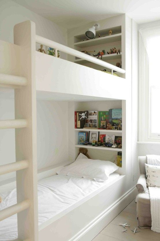 what about this shelving for the bed from the door to the wall, and the other bed (corner to window/ closet) is set out, and have shelving the length of the wall. could look very cute