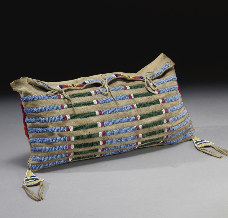 A CROW BEADED HIDE BAG composed of hide, wool cloth, glass beads and cotton thread. Width 12 3/4 in. Click to enlarge: http://assets3.pinimg.com/upload/137641332332888852_JhuPHv5i.jpg