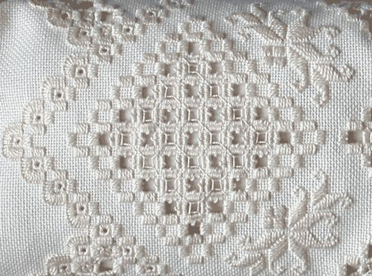 The white-on-white Hardanger embroidery is especially beautiful.