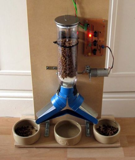 Web enabled automatic pet feeder. DIY with streaming webcam and webpage controls that let's you select how much food to dispense.