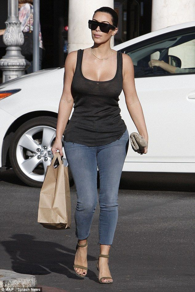 Grocery run: Kim Kardashian cranked up the heat in clingy tank top and skintight jeans as she stopped by Ralphs supermarket in LA on Saturday after taking daughter North to see a movie matinee