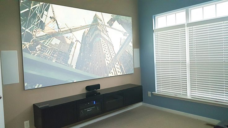 "120"" Elite Aeon Screen CineGray, BenQ projector, Polk Audio vanishing series in-wall speakers powered by the Denon A/V receiver."