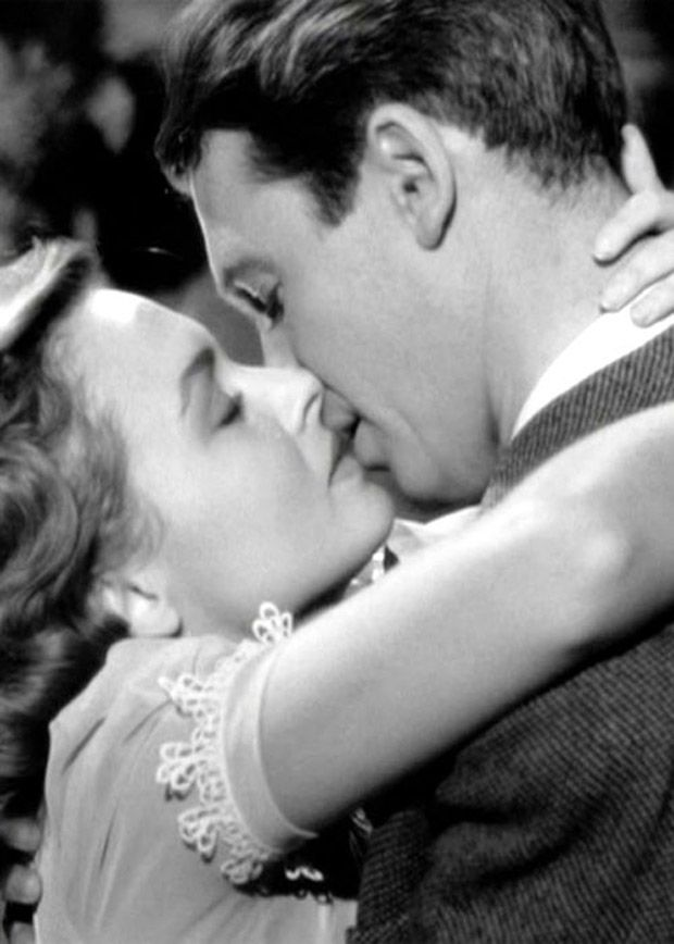 "Donna Reed & James Stewart in 'It's A Wonderful Life', by Capra, 1946. ""Wyler's 'The Best Years of Our Lives' was shot at the same time. Both films are optimistic, though both try to show an undercurrent of trouble within post-WWII society; In Capra's film, the character played by Jimmy Stewart nearly loses everything through a freakish chain of bad luck but finally recover through the help of this friends and neighbors"""