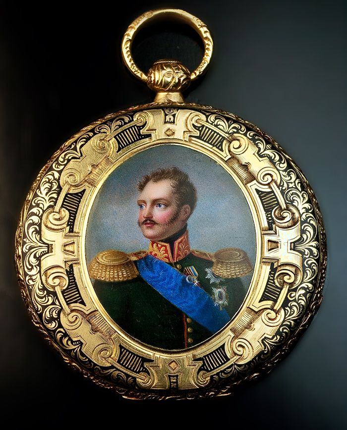 An Extremely Rare and Important Russian Imperial Presentation Watch, circa 1840,  made by Robert Brandt & Cie for the Russian Court. The ultra slim gold pocket watch is decorated with a finely enameled miniature portrait of Emperor Nicholas I - after the 1835 original painting by Franz Kruger - surrounded by an elaborately engraved, ornate black enamel frame.