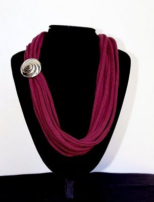 T shirt necklace with large pin.