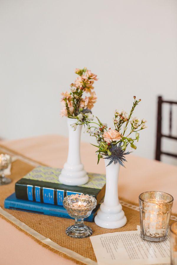 milk glass centerpieces, photo by Mary Margaret Smith http://ruffledblog.com/birmingham-botanical-gardens-wedding #weddingideas #weddingcenterpieces