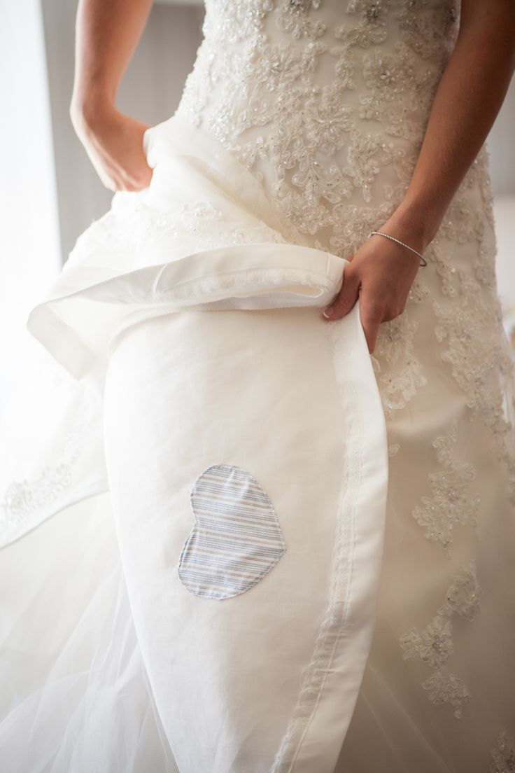 Something blue - a heart sewn into the bride's wedding dress in memory of her grandfather - Mark Nagel Portraits : San Diego Wedding Photography