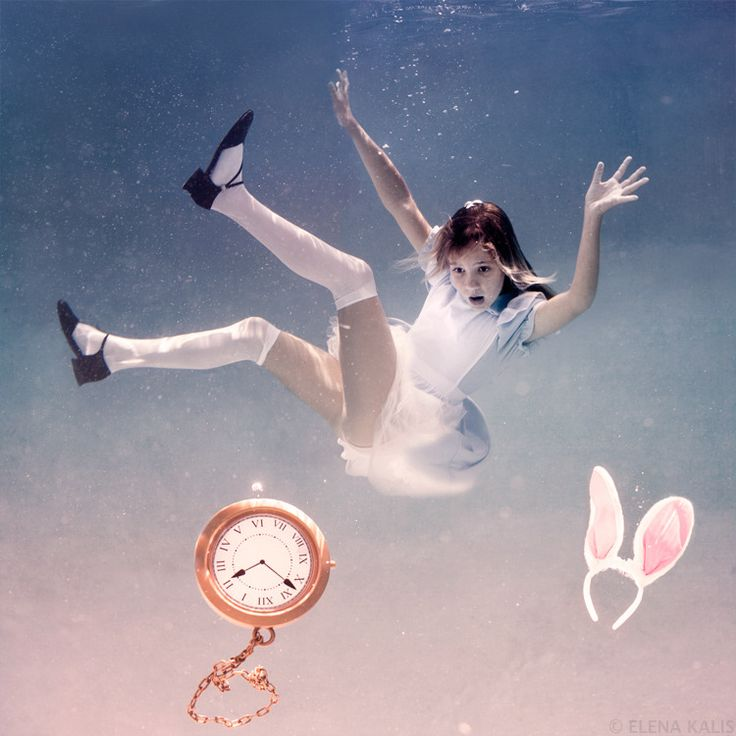 """Elena Kalis' Alice in Waterland and """"Looking Glass, a series of photos that re-enact Alice's adventures underwater, featuring flamingos, teacups, and even the White Rabbit's famous pocket watch. The images bring an entirely new brand of surreal beauty to Lewis Carroll's tale."""""""