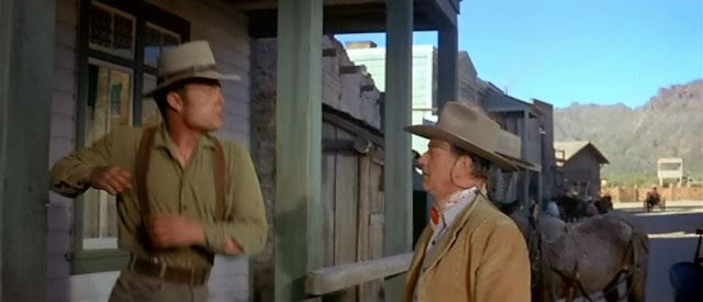 Patrick Wayne as Dev Warren and John Wayne as G.W. McLintock