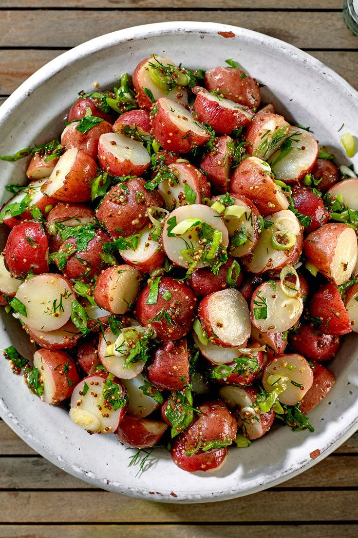 NYT Cooking: There's nothing complicated about this potato salad – it's really just boiled red potatoes tossed with a simple Dijon mustard vinaigrette and a generous smattering of scallions and fresh herbs –  and that's the beauty of it. It's delicious served cold or at room temperature, and its flavor gets better as it sits, making it an ideal dish to bring to a potluck or a%2...