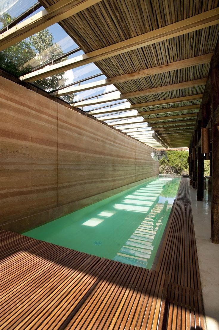 Oblique view of indoor lap pool at The Dalrymple Pavilion in South Africa designed by Silvio Rech and Lesley Carstens Architects and interiors