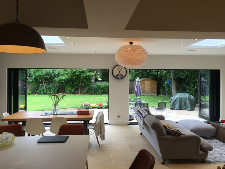 Beautiful custom-made bi-fold doors helping create an open flow into the garden.