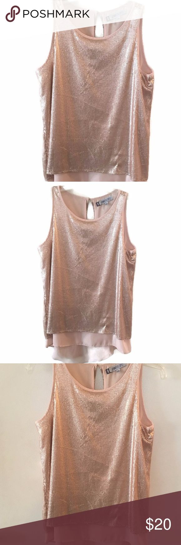 """Jennifer Lopez Rose Gold Sequin Sleeveless Top Sparkly Rosegold Sequin Top  Beautiful Festive Sleeveless Hi Lo Top Rose Gold Sequins Over top of Polyester Shell 100% Polyester Size Small Button Closure in Back Split Back Design Length: 25"""" in front 28"""" in back Armpit to Armpit: 19""""  EXCELLENT Used Condition Comes from Non-Smoking Home Jennifer Lopez Tops"""