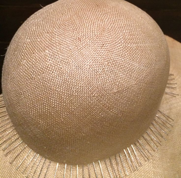 Linen straw cloche with floppy brim in the making.
