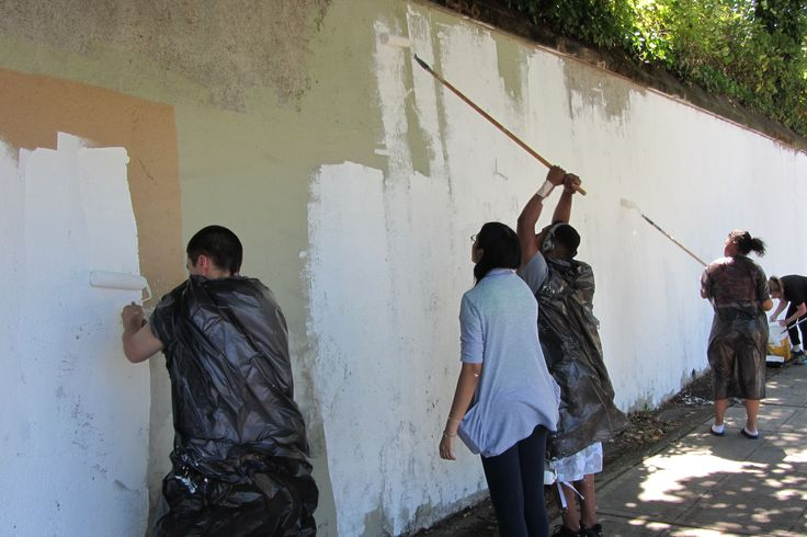 Priming the wall for painting.
