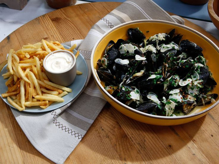 Classic Moules Frites recipe from Geoffrey Zakarian - remove mussels from pan - prepare sauce - pour over mussels