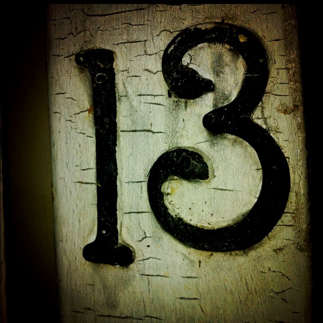 The number 13 on an old door facebook.com/jdubbstudio