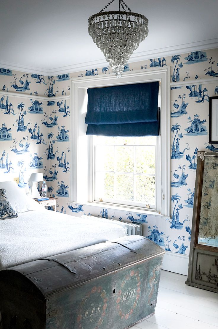 Bedroom covered in blue and white wallpaper: Bedroom covered in blue and white wallpaper