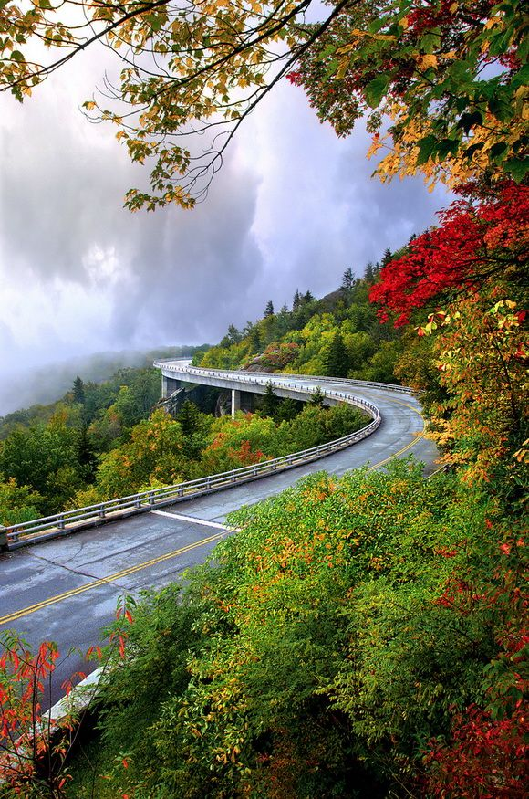 Incredible Drive Above the Trees - Linn Cove Viaduct;  a 1243-foot concrete segmental bridge on the Blue Ridge Parkway that snakes around the slopes of Grandfather Mountain in NORTH CAROLINA;  photo by (Kevin Childress) Mountains-to-Sea Trail Photo Contest, via Flickr