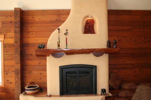 Fireplace -- Adobe small adobe fireplace with nook and shelf.