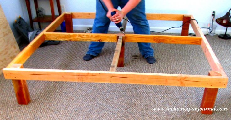 King size platform bed made with 2 x 4's, 4 x 4's and plywood - Securing support from top