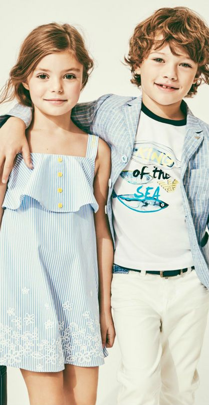 da1705a9 Armani Junior Girls Blue and White Striped Sundress and Boys King of the Sea  T-shirt for Spring Summer 2018. Cool Streetwear that's perfect for casual  ...