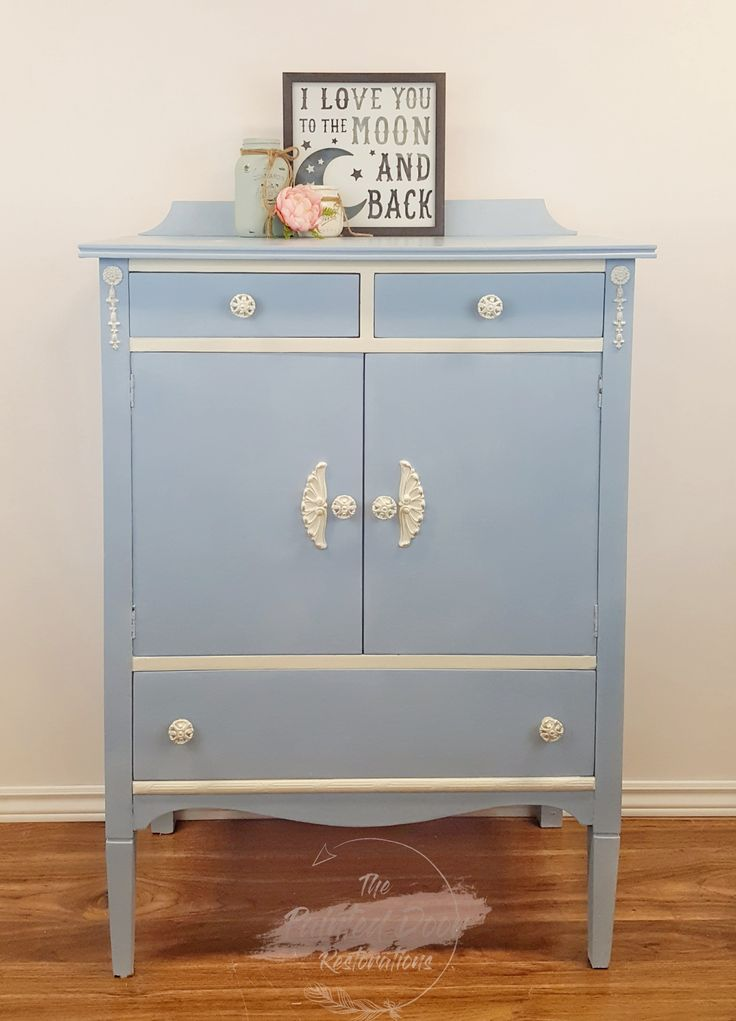 My third Annie Sloan piece. This antique dresser was painted in Louis Blue with Old White Detailing and drawers (inside.) I then used AS Silver Gilding Wax to bring out the detailing.