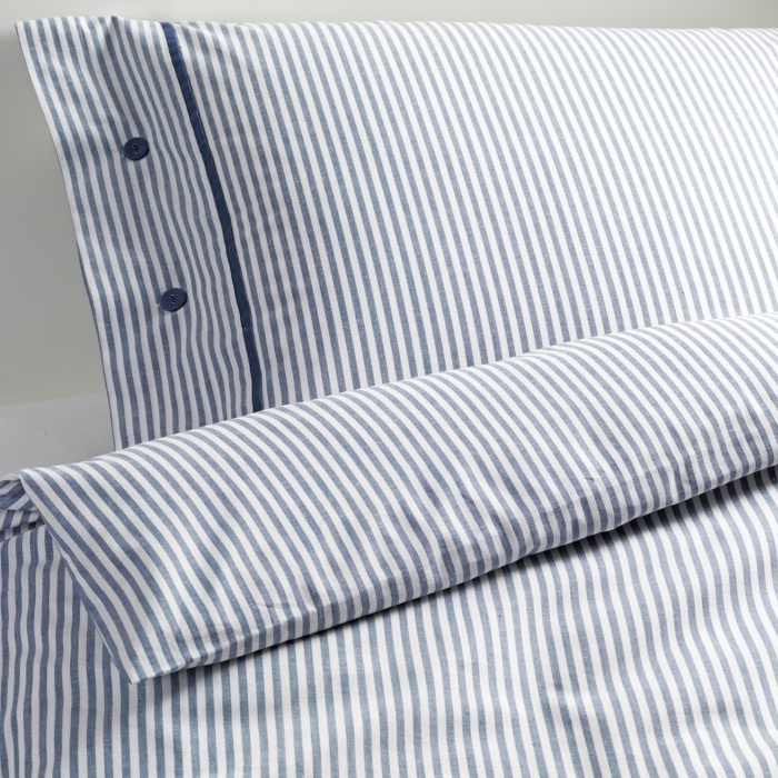 NYPONROS duvet, $39.99 for full and two pillow covers. Would lighten up the dark walls.