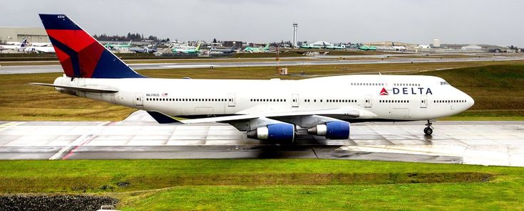 A Delta Air Lines 747 that will retire by year end, one of the last of these jumbo jets to fly for a U.S. carrier, visits its birthplace, Everett, on a farewell tour of the country on Monday. The jumbo jet lands at Paine Field on a wet and rainy morning. (Mike Siegel/The Seattle Times)