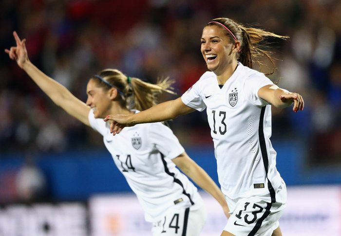 Alex Morgan of the U.S. women's soccer team celebrates a goal against Puerto Rico during the 2016 Women's Olympic Qualifying game on Feb. 10 in Frisco, Texas. The U.S. team will be going for its fourth straight gold, reflecting the dominance of American women at the Olympics, particularly in team sports.