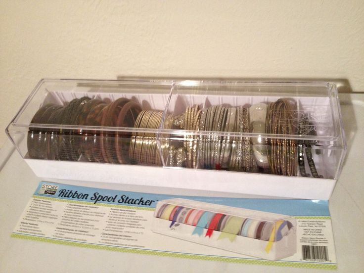 Ribbon spool container storage for storing bangle bracelets - genius!