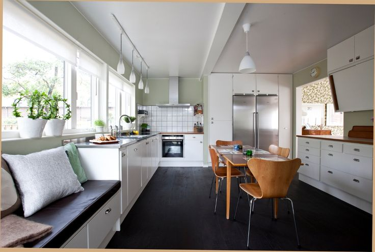 White cabinets, green walls