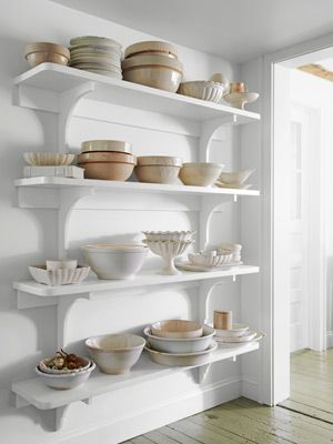 love the floor-to-ceiling open shelving