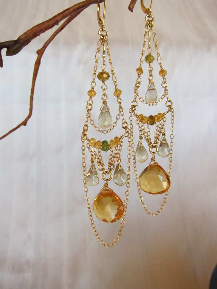 Defying description, these extraordinary intricate 14K Gold Chandelier Earrings cascading with Citrine, Peridot and Lemon Quartz define unique beauty which exists in the heart - Citrine, Peridot, Lemon Quartz 14K Gold Handmade Chandelier Earrings https://