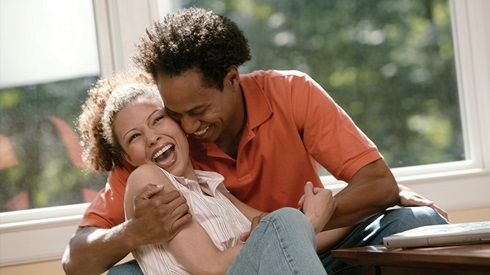 young couple laughing and hugging