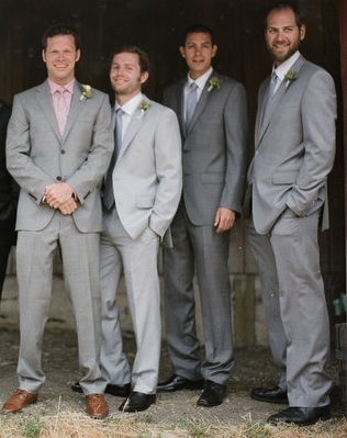 Groomsmen in different gray suits, white shirts no jacket. Groom in gray white and vest??