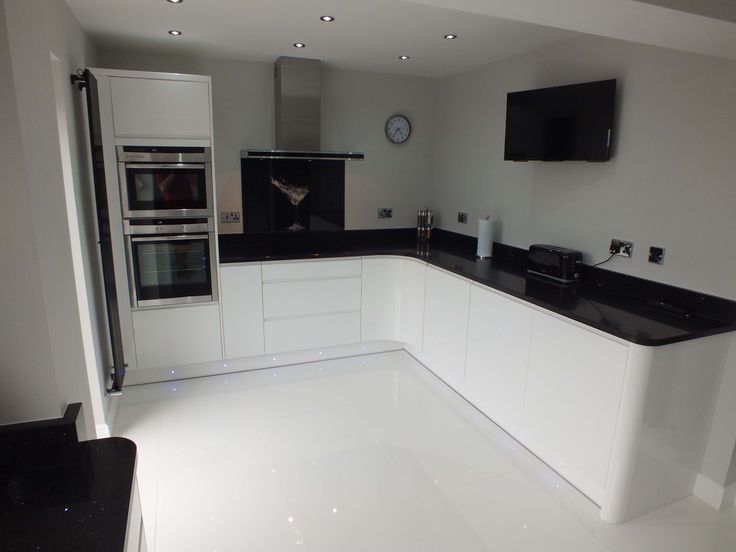 This monochrome kitchen is ultra sleek with handleless - White kitchen ideas that work ...