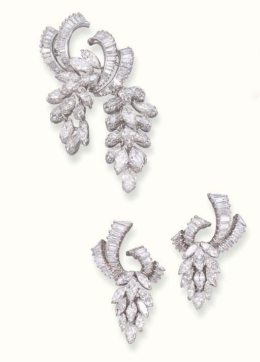A SET OF DIAMOND JEWELLERY Comprising a pair of ear pendants, each designed as a baguette-cut diamond ribbon top suspending a cluster of marquise-cut diamonds; and a brooch en suite, mounted in platinum