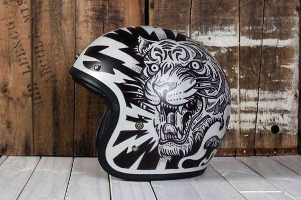 These are custom illustrated motorcycle helmets. The helmets are illustrated using a sharpie and sealed with an automotive clear coat. These helmets are DOT certified but should be considered art pieces. The artwork has not been tested to see how it would withstand the elements.
