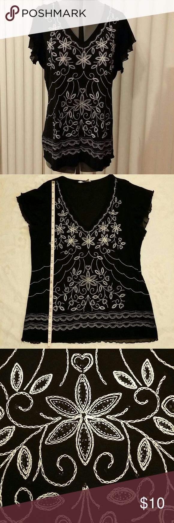 Cute Black and White Blouse Black short sleeve blouse with white floral design and small black sequins; 100% nylon, lining: 100% polyester; bought in the UK, so size is UK 22, which is equivalent to US size 18; good used condition - has only been hand washed. BHS (The British Home Store) Tops Blouses