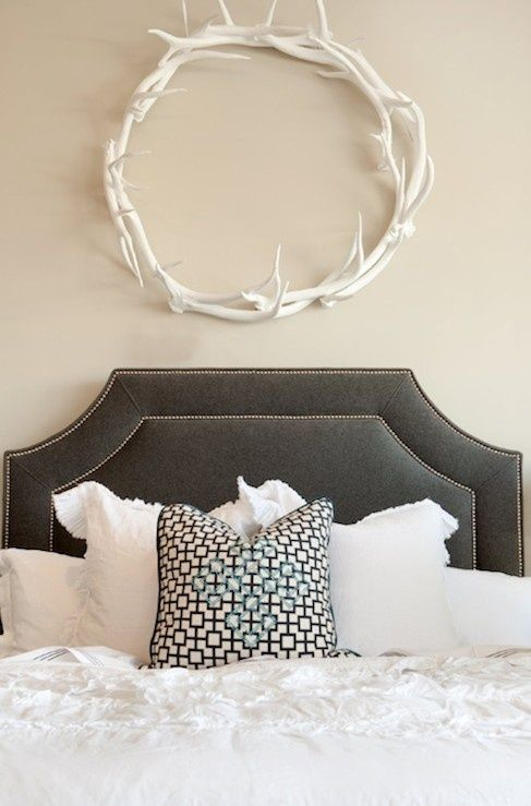 White antler wreath? Adds a little masculine touch without being too woodsy.