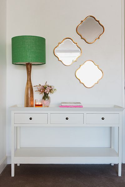 Rushcutters Bay Apartment - Emma Blomfield Interior Stylist Sydney. Entryway. Diamond Mirrors. White Console. Green Lamp. Table Decor Ideas.