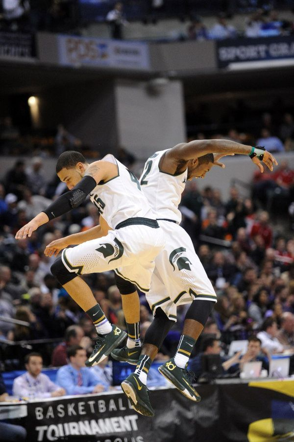 52ea9fd1e479 ... Denzel Valentine (45) and Branden Dawson (22) celebrate against the  Northwestern Wildcats Michigan State Spartans Nike ...