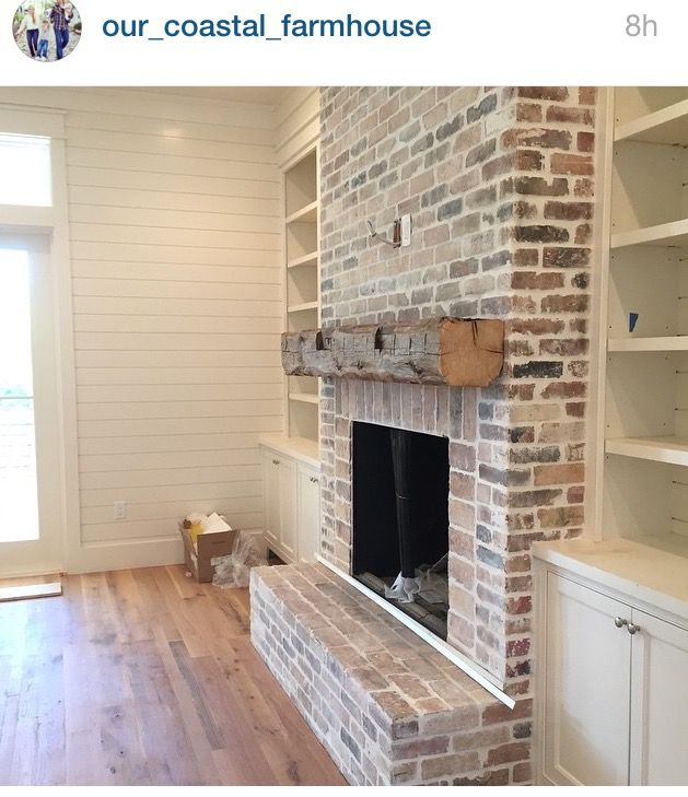 Brick surrounding and and timber mantle