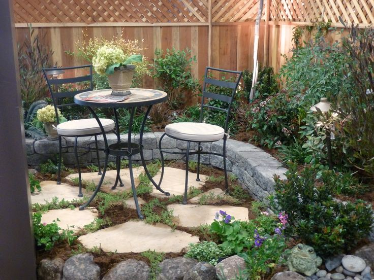 A bistro set placed on a small flagstone patio, makes an inviting garden  accent,. Front Yard IdeasFront ...